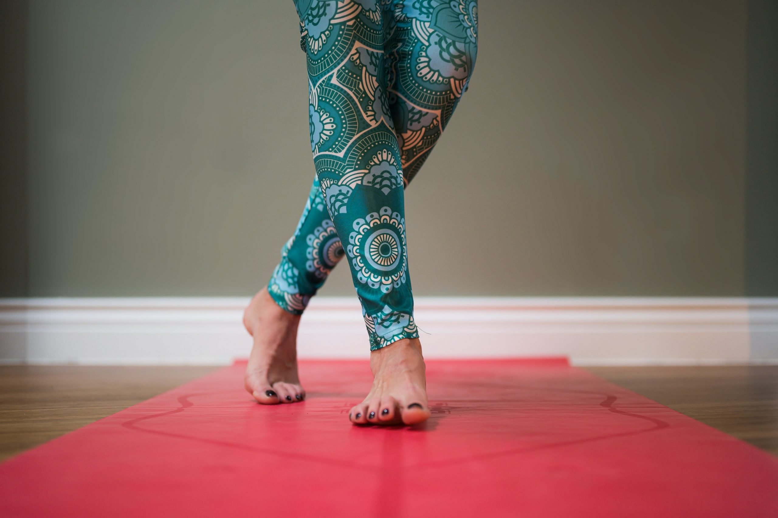 person in blue and white floral pants